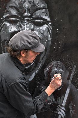 jef aérosol en train de peindre street art français