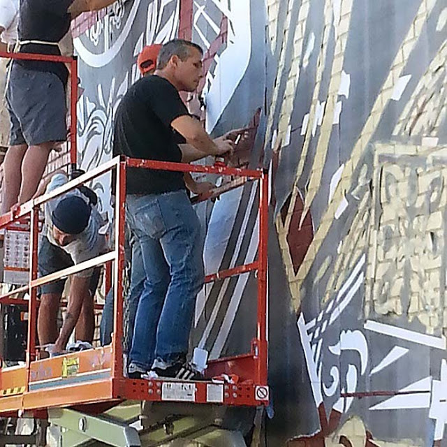 shepard fairey at work street art