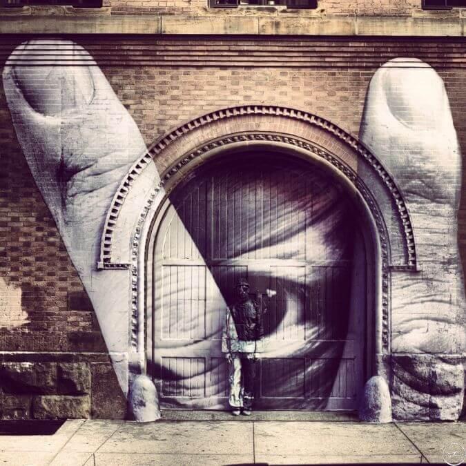 JR-street-art-yeux-doigts-rare.jpg