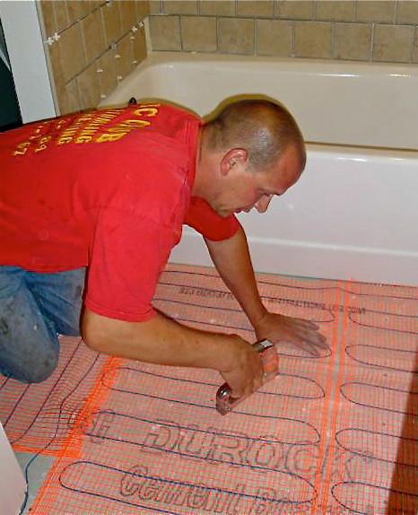 Eric J. installing radiant heat