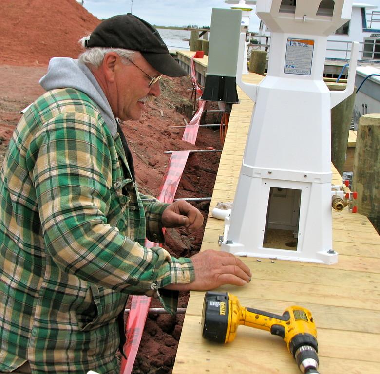 Eric L. Grüb installing water lines at a marina