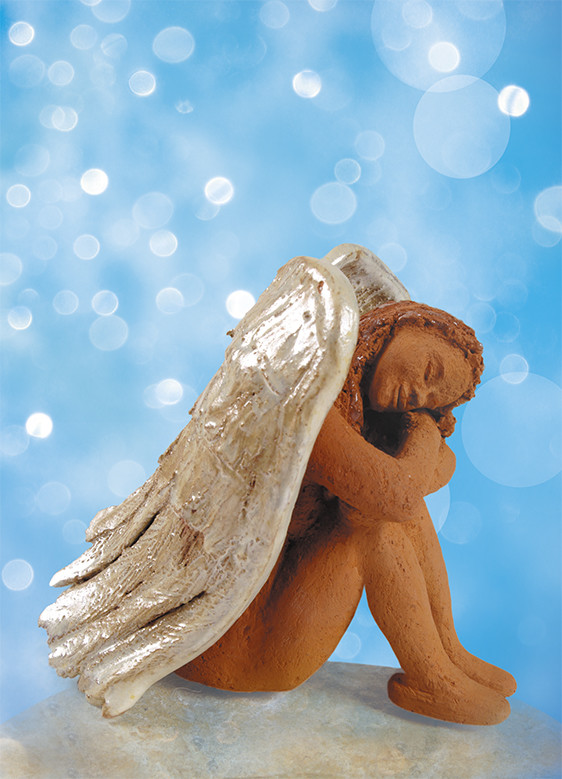 Kleine Hockende, Unikat aus gebranntem Ton, ca.  11 x 8 x 11 cm, partiell glasiert; Foto: Uwe Wagenfeld