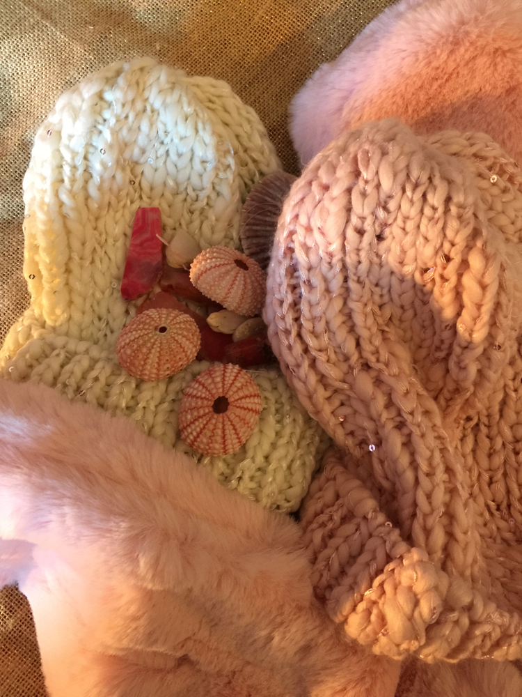 Pinks and creams like sunrises and sunset skies. Knit caps,faux fur scarves. Celebrate the holidays in these dreamy rose tones.