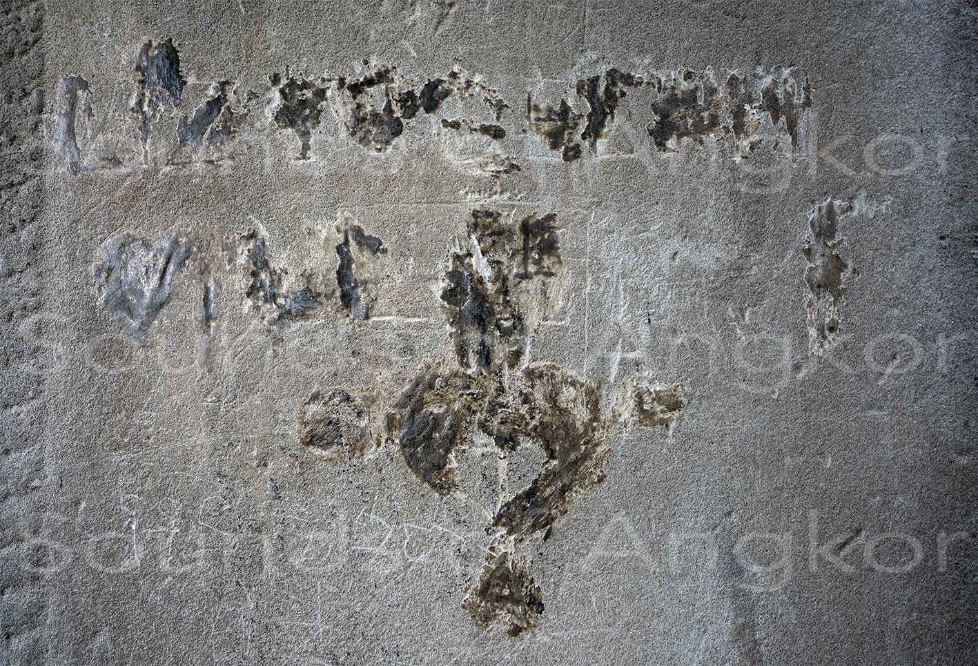 Graffiti au-dessous de l'autographe d'Émile Gsell.
