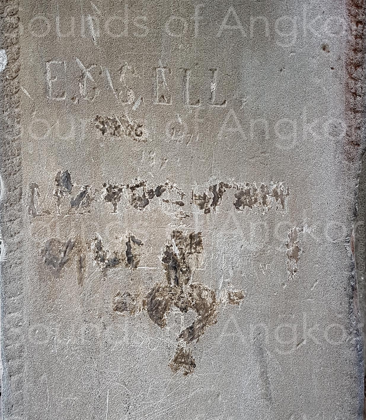 Autographie d'Émile Gsell et graffiti recouvert se trouvant au-dessous.