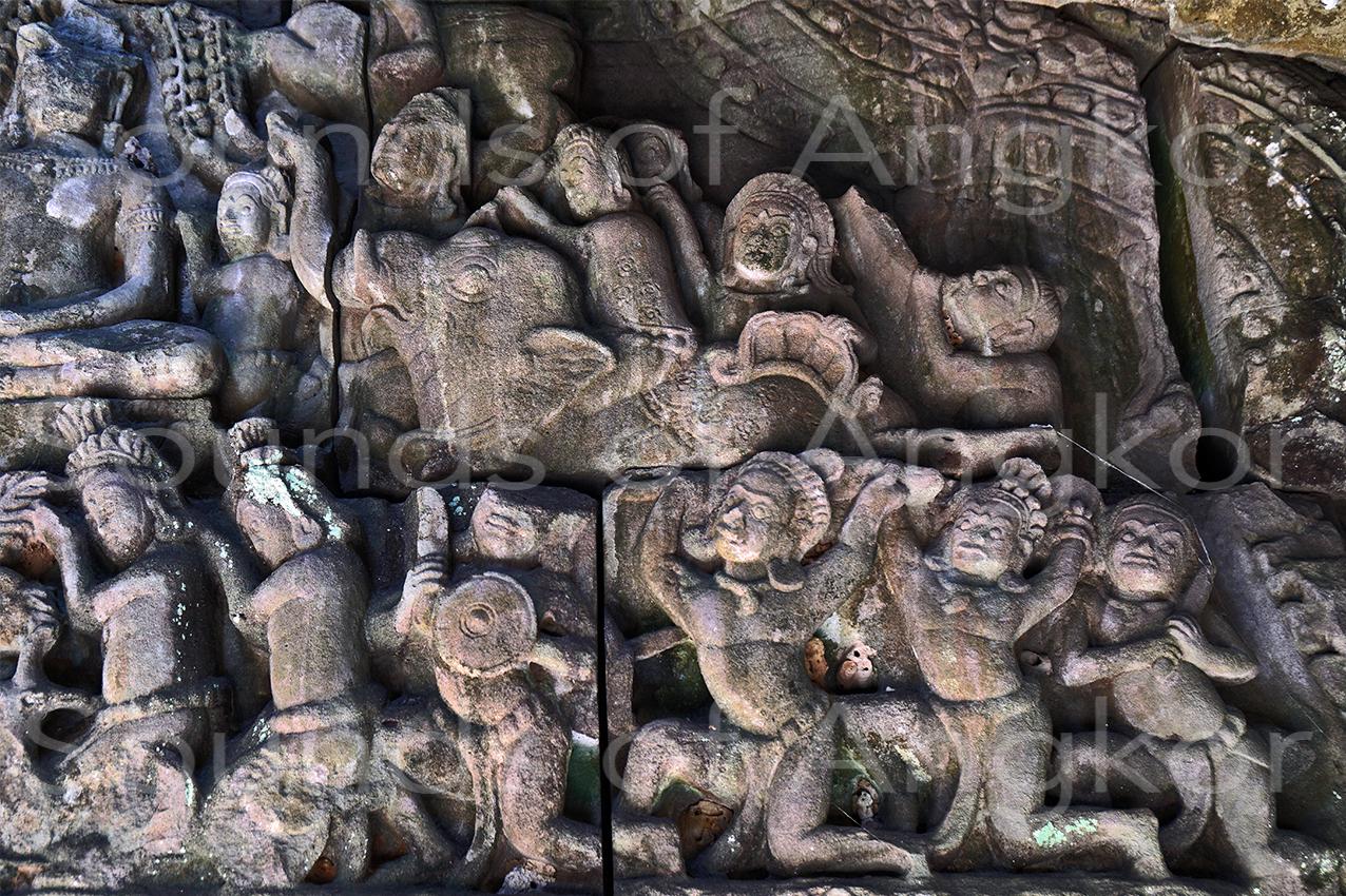 L'éléphant de droite, les soldats et le joueur de trompe. Original. Banteay Kdei.