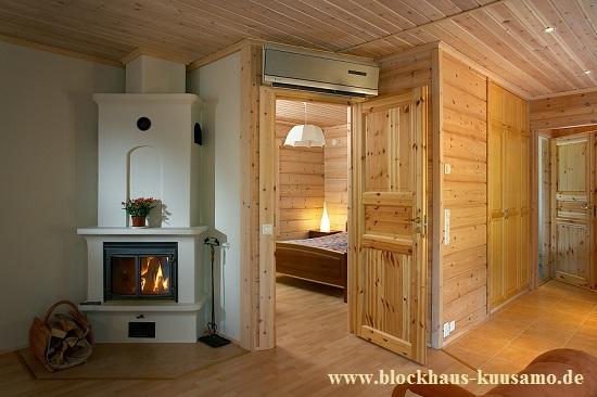 Nachhaltige Holzhäuser - schlüsselfertig - Kaminofen im Blockhaus - Blockhaus, Blockhausbau, Wohnblockhaus, Einfamilienhaus, Hausbau