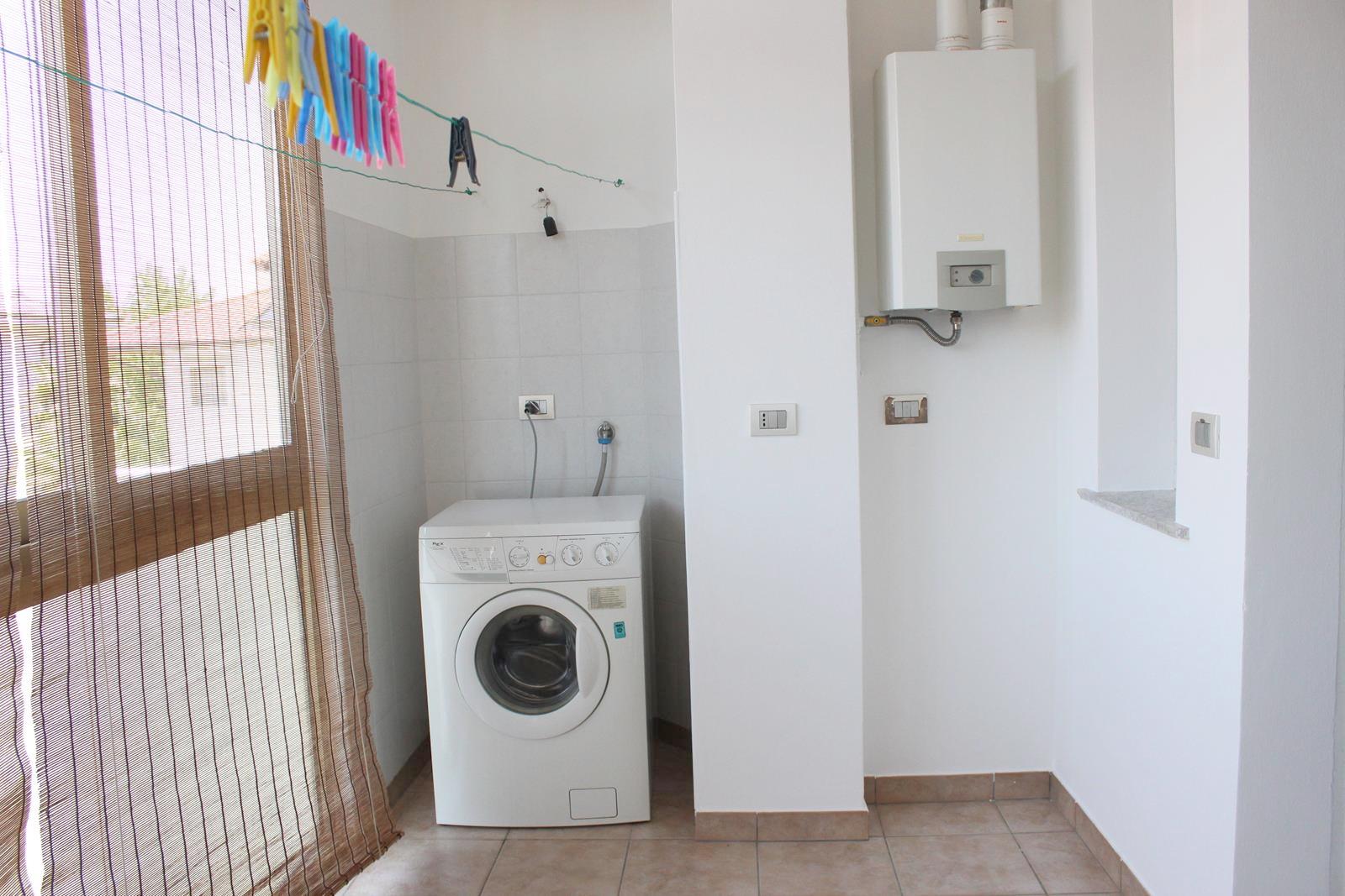 Terrazzo verandato con lavanderia