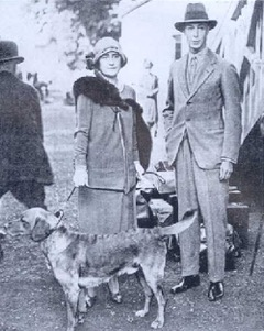 """King George VI and Queen Elizabeth with their dark yellow Labrador in the 1920's"""