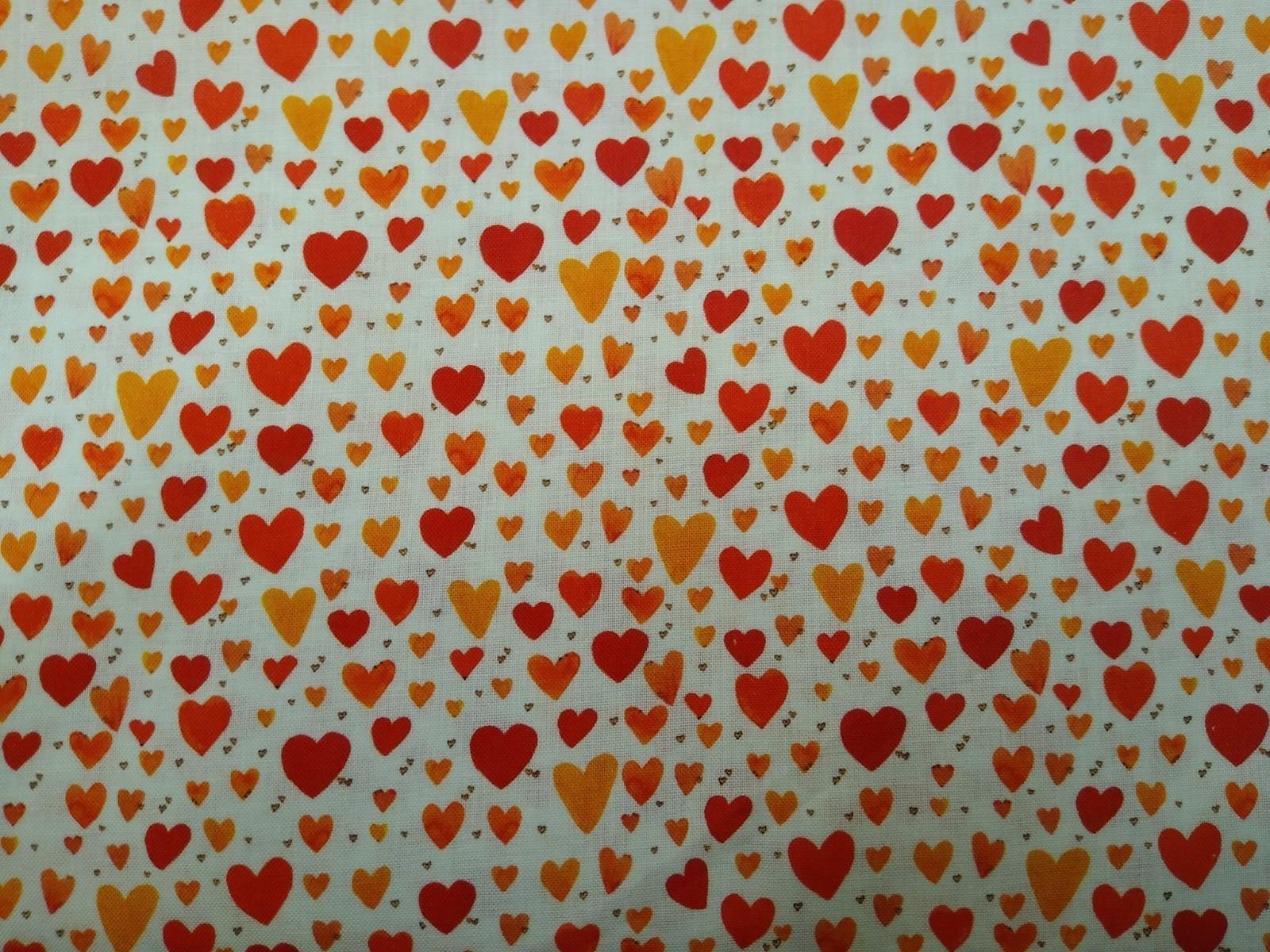 Baumwolle Herzen orange rot, 110cm breit, 0.5m 10.00€