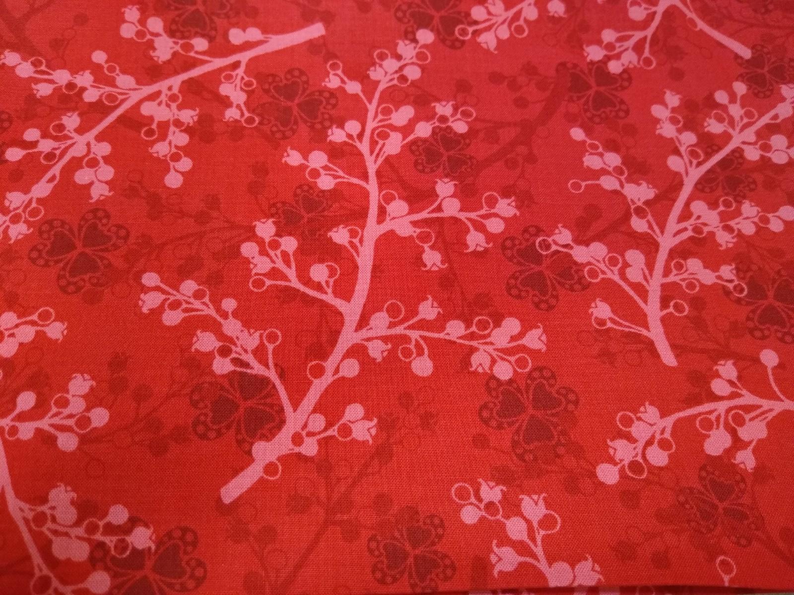 Baumwolle Zweige/ Blätter rot, 110cm breit, 0.5m 10.00€