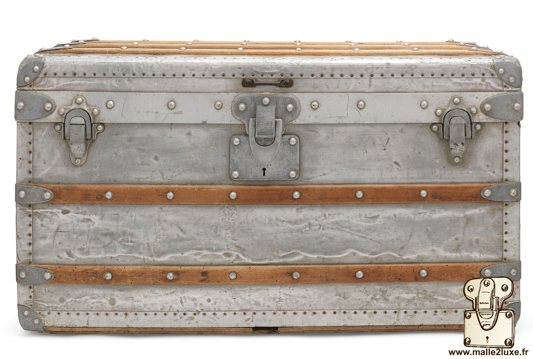 Louis Vuitton Low Courier Trunk Year: 1892 Outside: Solid aluminum Border and corners: Solid aluminum Lock, clasps and handles: Solid aluminum Nails: Solid Aluminum Marked Louis Vuitton