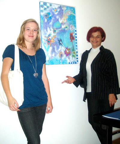 Taina T. Franjevic and Rajka Poljak Franjevic in front of Vlado's artwork