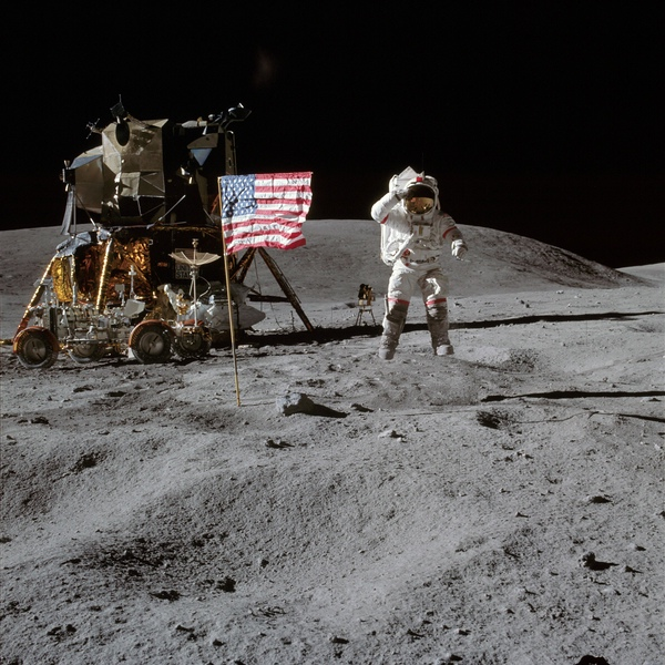 Astronaut John Young leaps from lunar surface to salute flag,