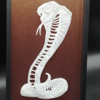 <h2>cadre cobra en dentelle de papier<h2>