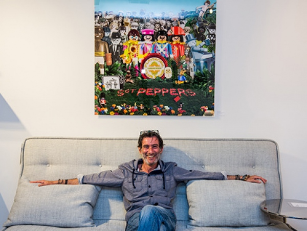 The artist, Richard Unglik, in front of the limited edition print of Sgt Pepper's in 39''x39''.