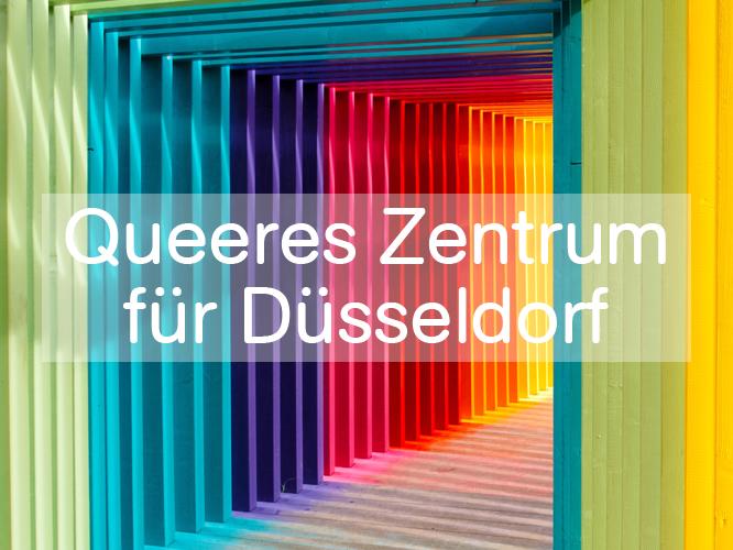 """Bild: Tunnel in Regenbogenfarben mit Schriftzug """"Queeres Zentrum für Düsseldorf"""""""