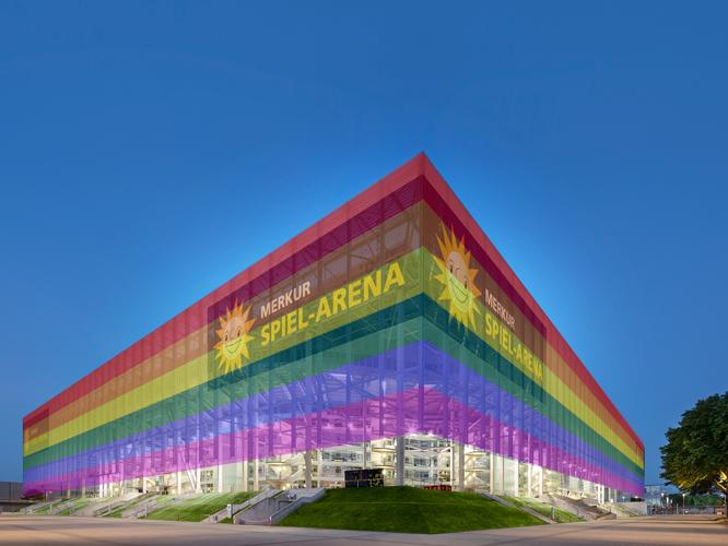 Bild: MERKUS SPIEL-ARENA in Düsseldorf (Bildmontage mit Regenbogenfarben)