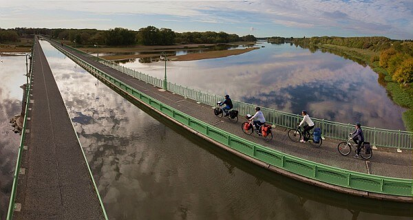 Cycling on Briare canal-bridge near L'Echappée Belle