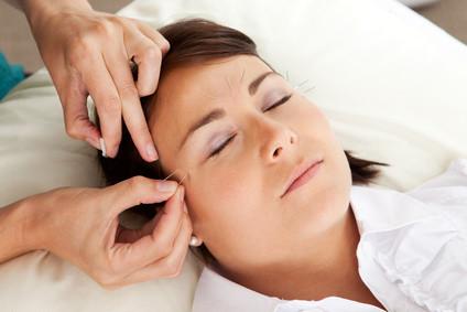 Therapie mit Druck und Nadel