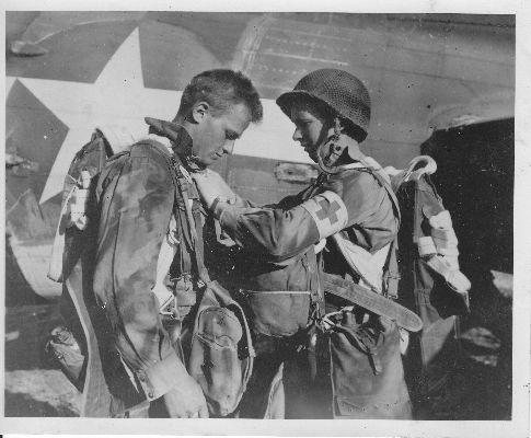 Checking parachutes, Doc LECKLIDER on the right