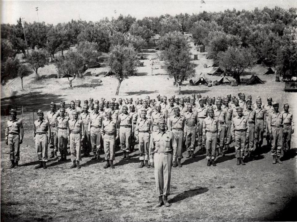 """D"" Battery , 460th Field Artillery Battalion , Italy 1944 / Captain George SCHNEBLI commanding officer."