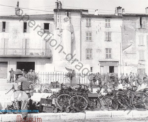 Men of the 550th in the town square of Le Muy, collect the material abandoned by the germans
