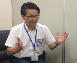 北海道新聞社販売局 田中秀実部長