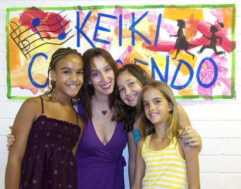 Claudia McDowell with children in music school Keiki Crescendo in Kailua Hawaii USA