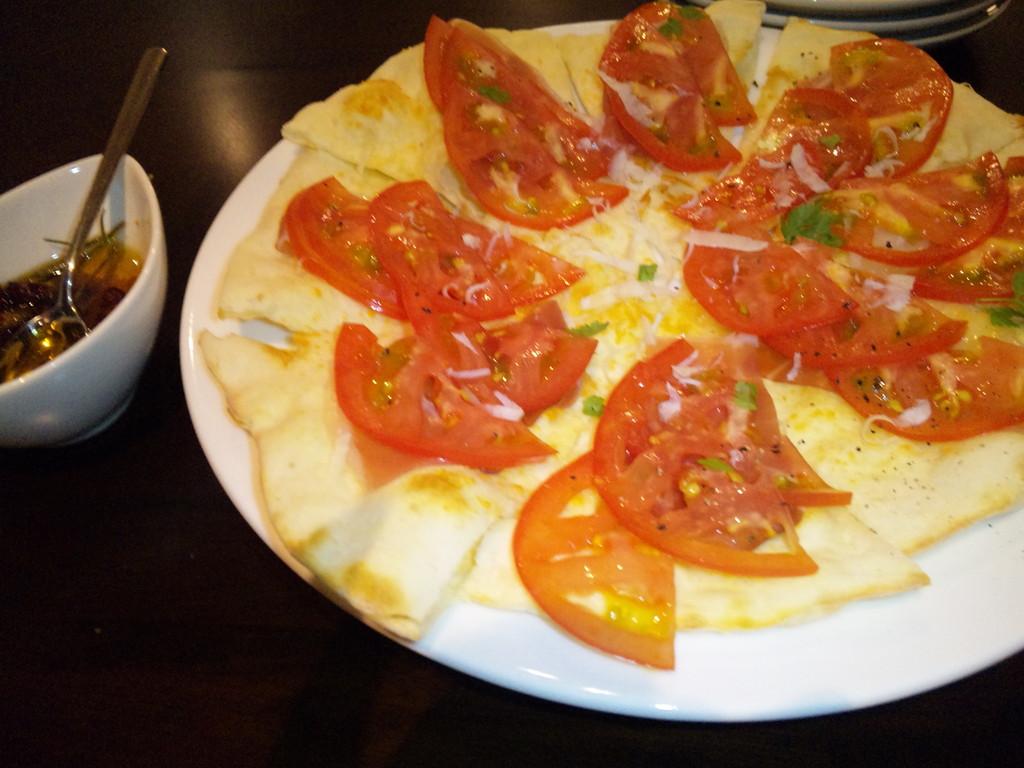 プロシュートとトマトのピッツァ