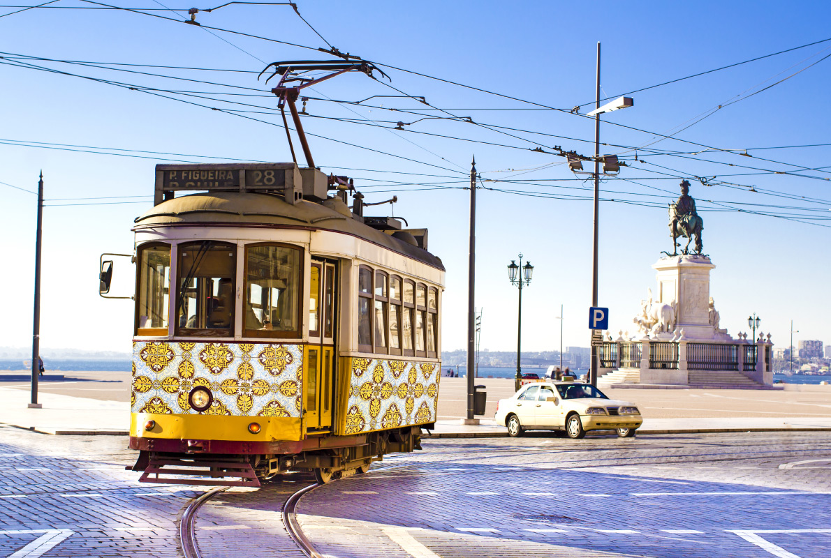 Best trams in Europe - Vintage yellow tramway at the Commerce Square in Lisbon Copyright  c  - European Best Destinations