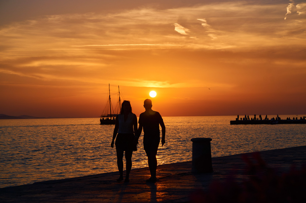 A couple walking in front of the sunset in Zadar, Croatia - Copyright Bernhard Ivancsics