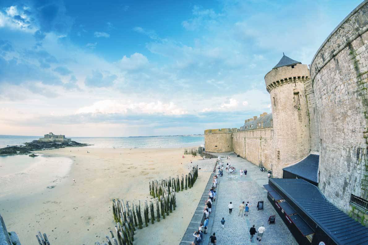 Best fortified destinations in Europe  - Saint Malo beach and city medieval architecture during Low Tide. Brittany, France, Europe Copyright Pisaphotography - European Best Destinations