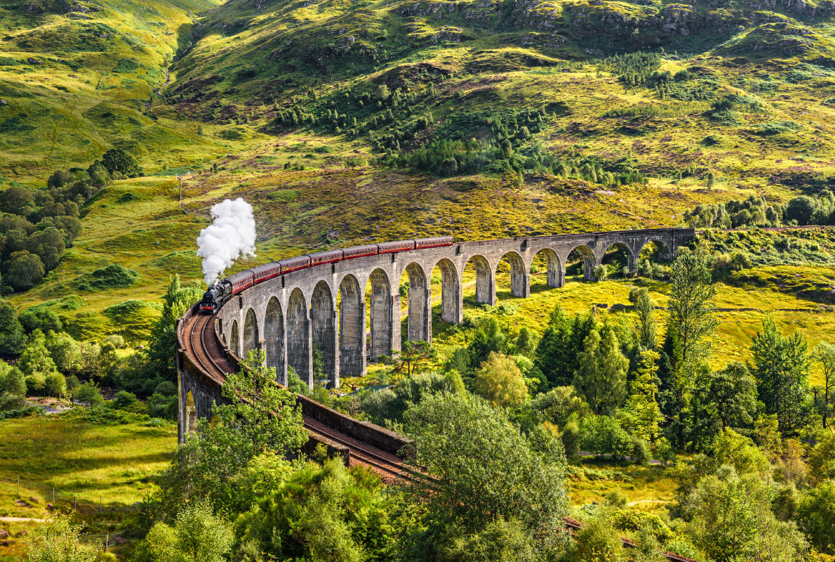 Best destinations to visit by train - Glenfinnan Railway Viaduct in Scotland with the Jacobite steam train passing over Copyright Nick Fox - European Best Destinations