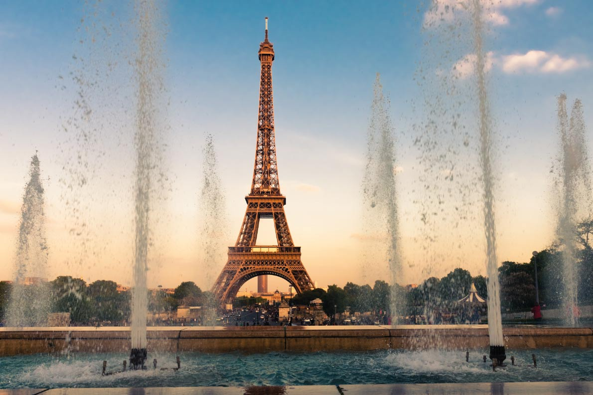Best fountains in Europe  Eiffel Tower (La Tour Eiffel) with fountains. Beautiful sunset landscape in Paris Copyright Valeri Potapova - European Best Destinations