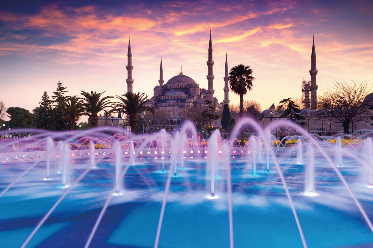 Best fountains in Europe Colorful spring sunset in Sultan Ahmet park in Istanbul, Turkey, Europe. Colorful fountain on the background of the Loonic Blue Mosque. Artistic style post processed photo. Copyright Andrew Mayovskyy  - European Best Destinations