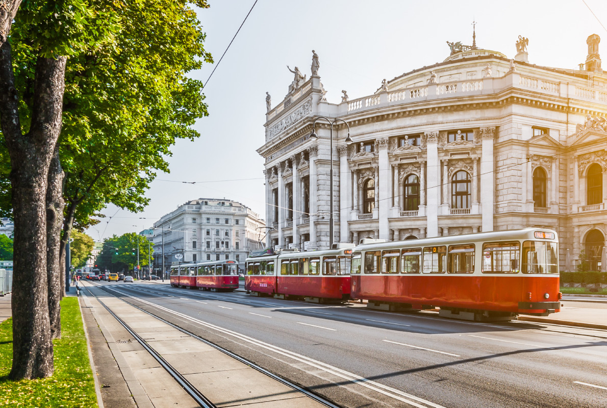 Best trams in Europe -  red electric tram at sunrise with retro vintage Instagram style filter effect in Vienna, Austria Copyright  canadastock   - European Best Destinations