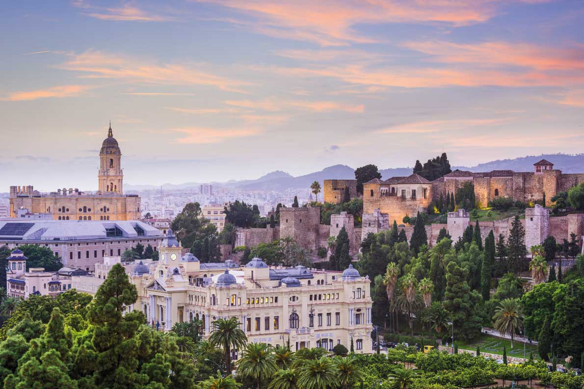 Best fortified destinations in Europe Malaga, Spain cityscape at the Cathedral, City Hall and Alcazaba citadel of Malaga. Copyright ESB Professional