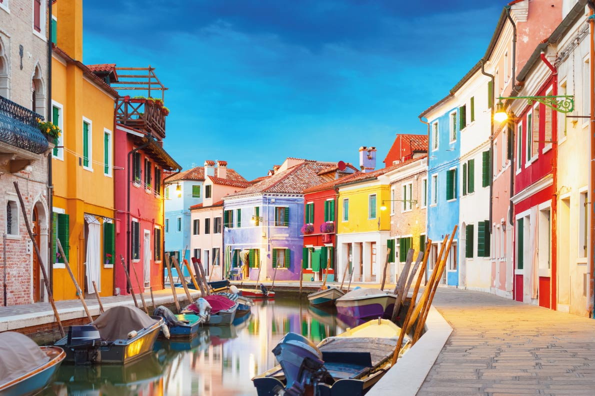 Colorful destinations in Europe  - Colorful houses at night in Burano, Venice Italy. Copyright waku - European Best Destinations