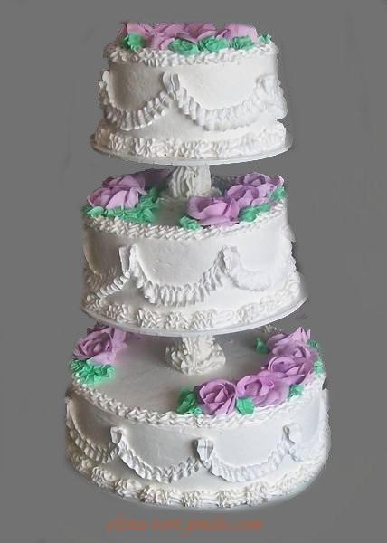 Трехъярусный кремовый  торт на подставке с розовыми и белыми розами, 8 кг