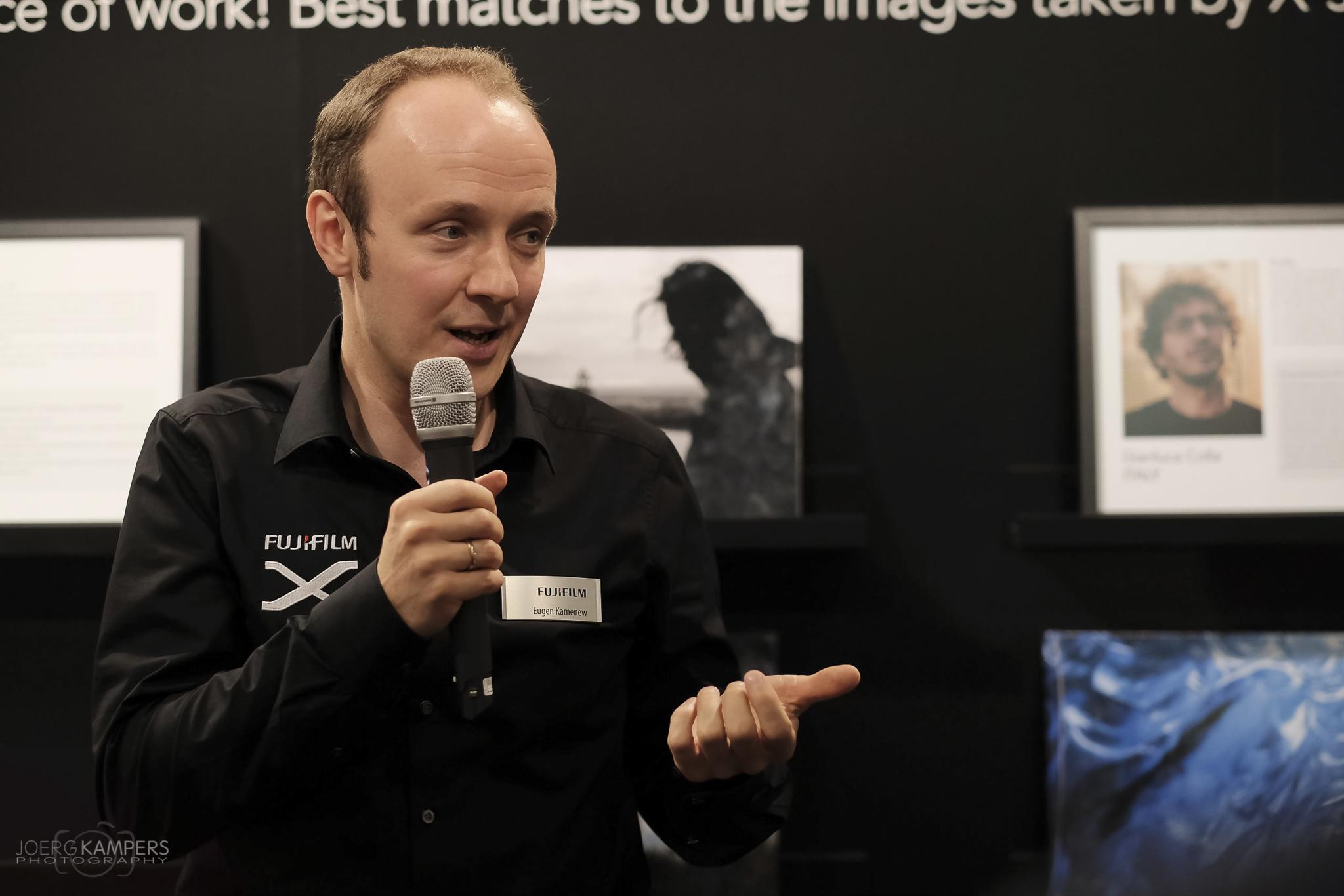 Eugen Kamenew (official Fujifilm X-Photographer) at Photokina 2016 giving a public speech