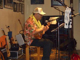 Cow plays ukulele.