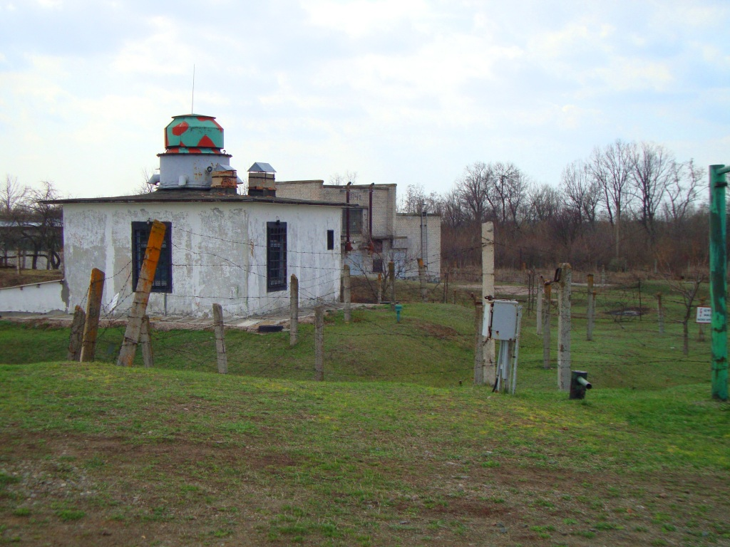 A guardhouse with machine gun turret