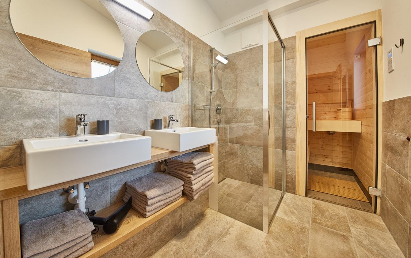 Alpenrose bathroom with double-sinks and sauna