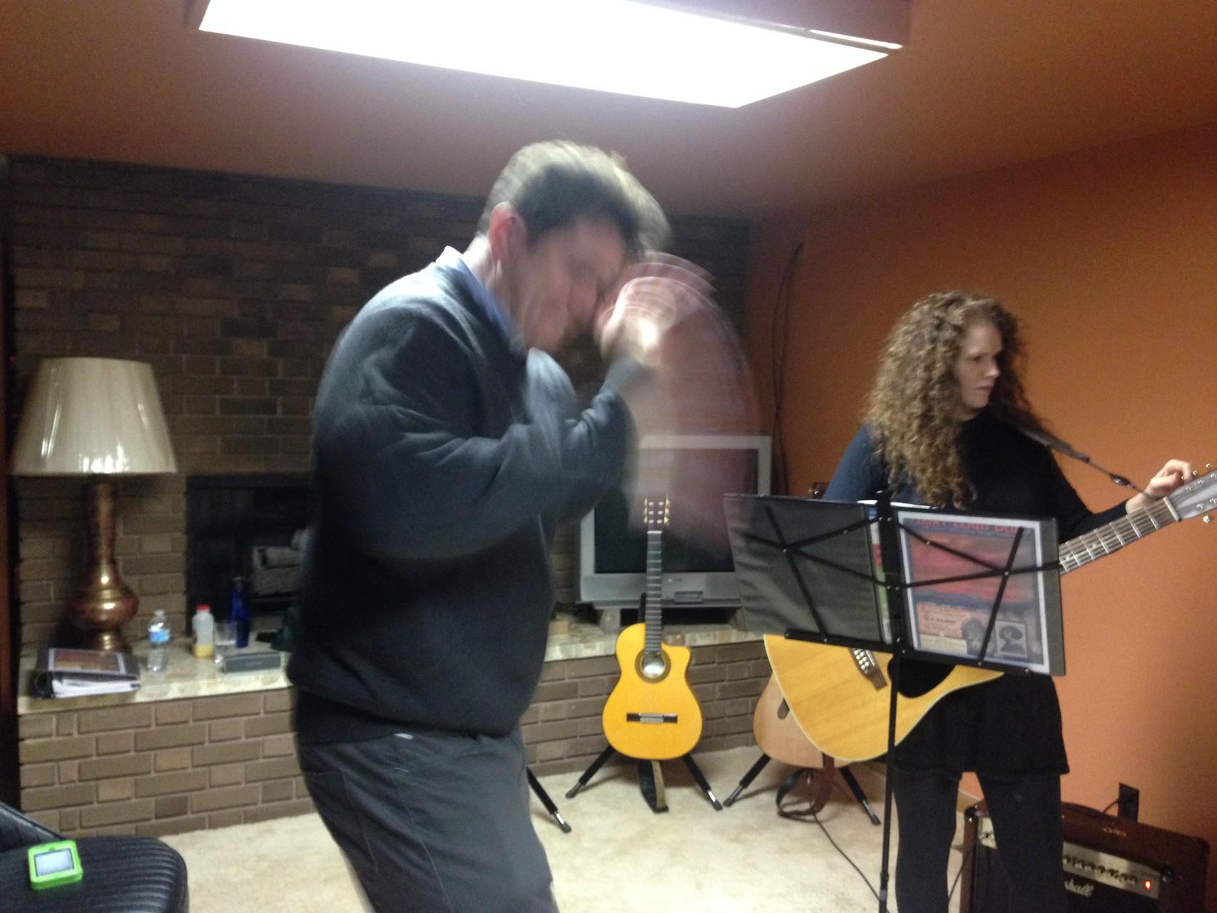 John warming up for the bongos