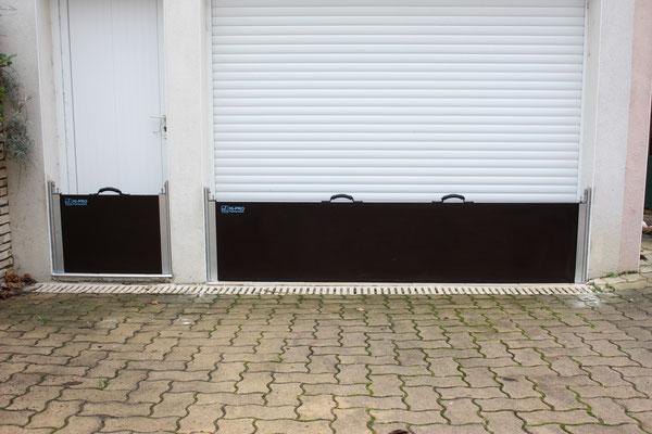 Photo de l'installation d'une barrière anti crue pour porte et d'une barrière  contres les inondations pour baie vitrée, chantier réalisé en France