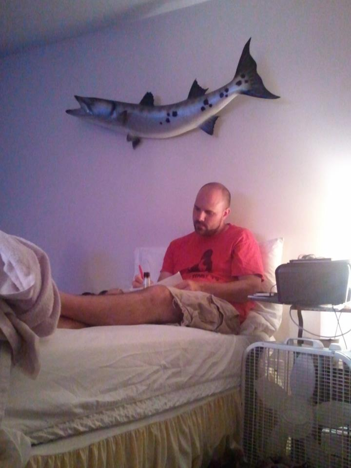 Tony Wash working on his shot list for the next day.  The barracuda was brought to set as an art piece and was hung in Tony and Rob's motel room.  Tony's dad caught that beast!