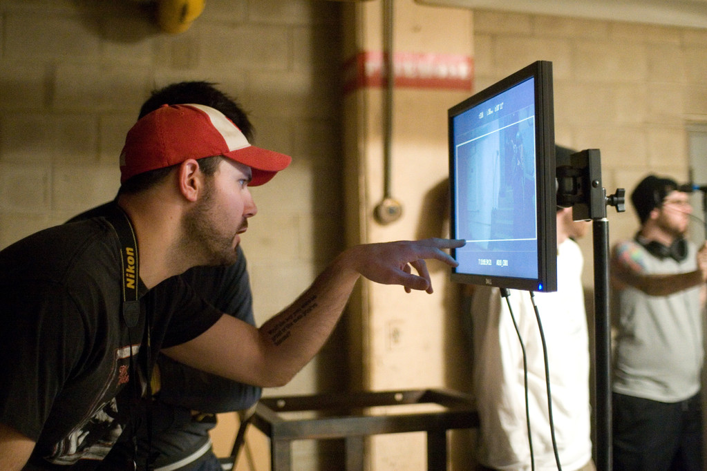 Director Tony Wash pointing out some FX details on the monitor.