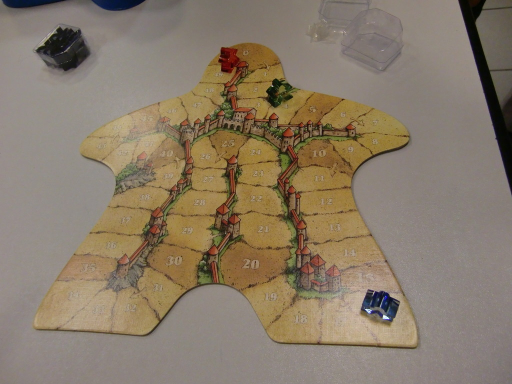 """l'élégant plateau format """"meeple"""" de l'édition anniversaire de Carcassonne"""