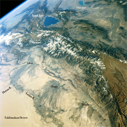 Spectacular scene of Tienshan mountains lies to the north and west of the Taklamakan Desert view from space. ©NASA/GSFC.